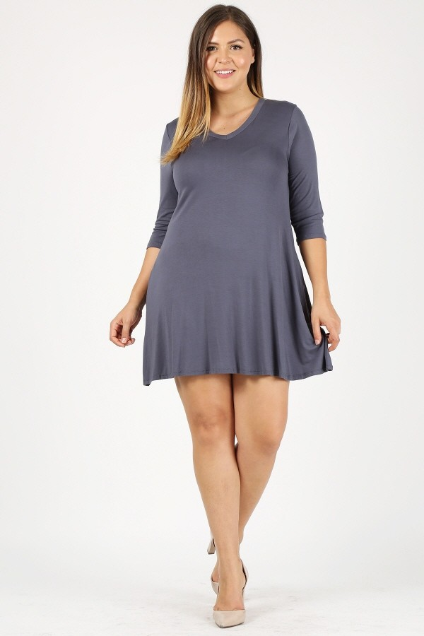 Plus Size Solid 3/4 Sleeve Loose Fit Knit Tunic Top With Sides Pockets
